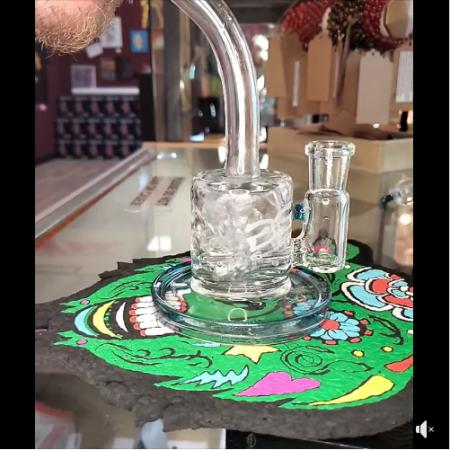 Check out the function on this @geos_glass mini can banger hanger in clear and atomic stardust Perfect little pocket rig for on-the-go rips Just $ for TODAY, STOP ON IN Open everyday from 9am-10pm Call us at 815-904-9920 Turn those post notifications ON #thebubblehive #rockfordillinois #rockfordglassshop #headshop #headshoplife #headyglass #glassofig #420 #710community #glasscollector #geosglass